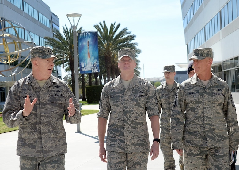 Chief Master Sgt. of the Air Force James A. Cody (center) is escorted by Maj. Gen. Robert McMurry, Space and Missile Systems Center vice commander and Chief Master Sgt. Craig Hall, SMC command chief, during a visit to Los Angeles Air Force Base in El Segundo, Calif., March 9-11, 2016 to discuss the current state of the Air Force from an enlisted perspective. The CMSAF's visit offered active duty and civilian personnel a rare opportunity to directly address the service's senior enlisted leader regarding the issues facing today's Airmen. It also gave Chief Cody a chance to view the unique characteristics of Los Angeles AFB and the capabilities the Total Force offers to accomplish the SMC mission. (U.S. Air Force photo/Van De Ha)