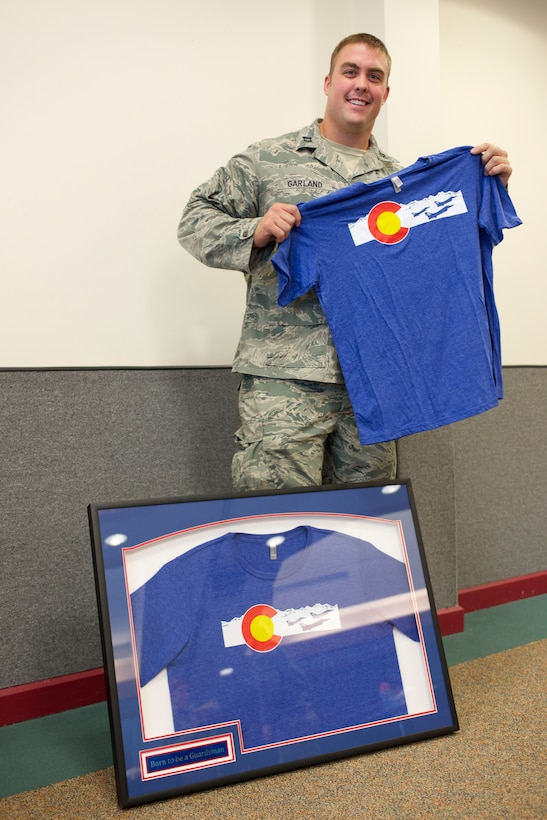 U.S. Air Force Capt. Benjamin N. Garland, Public Affairs Officer and offensive lineman for the Atlanta Falcons, assigned to 140th Wing, receives a token of thanks from the Army National Guard at Buckley Air Force Base Feb. 21, 2016. Garland designed a curriculum and trained service members, alongside Army National Guardsmen, about the importance of reporting concussions, military protocol and early treatment. (U.S. Air National Guard photo by Senior Airman Bobbie Reynolds)