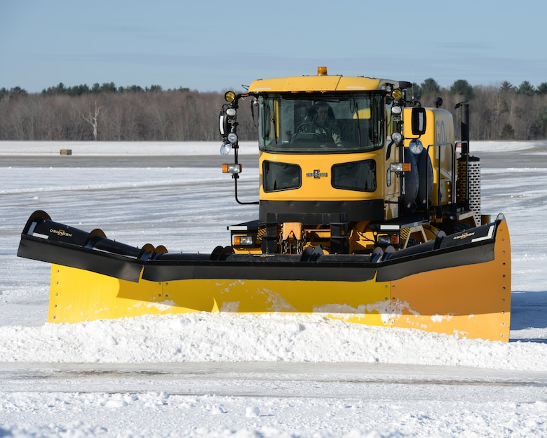 A U.S. Air Force Airman from the 157th Civil Engineer Squadron, New Hampshire Air National Guard drives a snow plow to clear snow, Pease Air National Guard Base, N.H., April 5, 2016. (U.S. Air National Guard photo by Staff Sgt. Curtis J. Lenz)