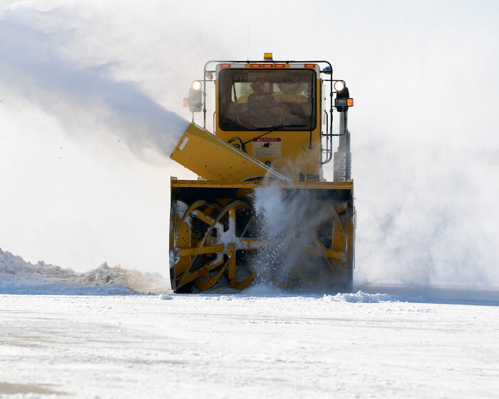 U.S. Air Force Tech. Sgt. Benjamin M. Kipp, from the 157th Civil Engineer Squadron, New Hampshire Air National Guard drives a blower to clear snow, Pease Air National Guard Base, N.H., April 5, 2016. (U.S. Air National Guard photo by Staff Sgt. Curtis J. Lenz)