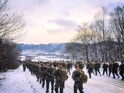 Marines from Headquarters and Service Company conduct a conditioning hike to acclimatize to the new environment Jan. 18, during their recent deployment to Rodriguez Life Fire Complex in the Republic of Korea. The Marines are from Combat Assault Battalion, 3rd Marine Division, III Marine Expeditionary Force, forward deployed in the Pacific.