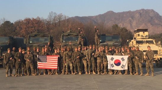 Marines from Motor Transport Platoon display the US and South Korean Flags Jan. 18, during their recent deployment to Rodriguez Life Fire Complex in the Republic of Korea. The Marines are from Combat Assault Battalion, 3rd Marine Division, III Marine Expeditionary Force, forward deployed in the Pacific.
