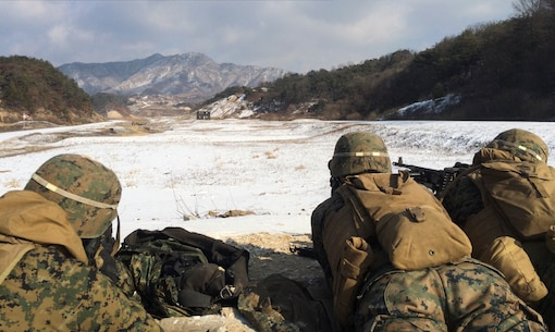 Marines from 3rd Platoon, Combat Engineer Company, Combat Assault Battalion, observe the impact of 7.62 mm rounds Jan. 28 at Rodriguez Live Fire Complex, Republic of Korea. The Marines are from Combat Assault Battalion, 3rd Marine Division, III Marine Expeditionary Force, forward deployed in the Pacific.