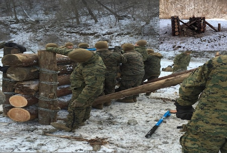 Marines from 3rd Platoon, Combat Engineer Company, Combat Assault Battalion, tie logs together with barbed wire to create obstacles Jan. 28 at Rodriguez Live Fire Complex, Republic of Korea. The Marines are from Combat Assault Battalion, 3rd Marine Division, III Marine Expeditionary Force, forward deployed in the Pacific.