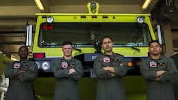 Lance Cpl. Jeremie Lewis, Lance Cpl. Quinn Beckens, Lance Cpl. Rodrigo Cruzvera and Lance Cpl. Javier Avila Jr. pose for a photo in front of their fire truck April 1, 2016. The Marines are aircraft rescue and firefighting Marines with Headquarters and Headquarters Squadron, Marine Corps Air Station Futenma, Marine Corps Installations Pacific.