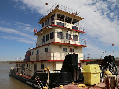 The newly refurbished Mr. Pat floats, tied to a barge on the McClellan-Kerr Arkansas River Navigations System at Lock & Dam 14 near Spiro, Oklahoma.  Mr. Pat is the Tulsa District, U.S. Army Corps of Engineers tow boat that facilitates the movement of a 150 foot barge, housing a crane used for major repairs on the five lock & dam systems of the MKARNS within the Tulsa District. (Photo by Preston Chasteen/Released)