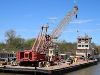 The newly refurbished Mr. Pat floats, tied to a barge on the McClellan-Kerr Arkansas River Navigation System at Lock & Dam 14 near Spiro, Oklahoma.  Mr. Pat is the Tulsa District, U.S. Army Corps of Engineers tow boat that facilitates the movement of a 150 foot barge, housing a crane used for major repairs on the five lock & dam systems of the MKARNS within the Tulsa District.