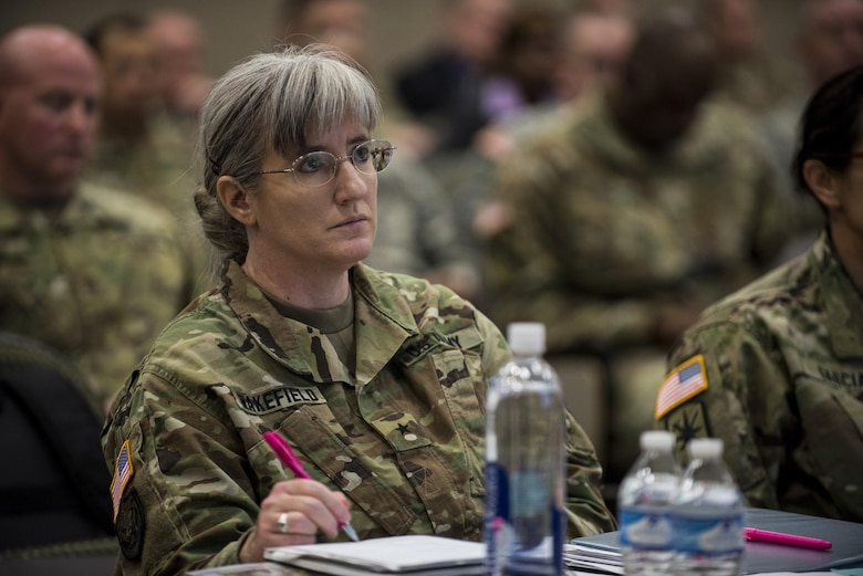 Brig. Gen. Kelly Wakefield, deputy commanding general (support) for the 200th Military Police Command, takes notes while listening to a presenter at a Yearly Training Brief conference held in Columbus, Ohio, April 2. During the event, battalion and brigade leaders worked to improve their readiness and briefed the commanding general and his command leadership on their units' status. (U.S. Army photo by Master Sgt. Michel Sauret)