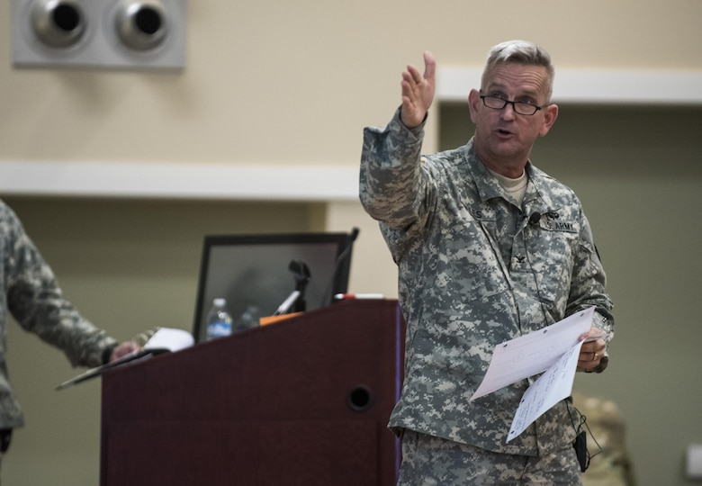 Col. Richard Giles, U.S. Army Reserve commander of the 300th Military Police Brigade, gives a presentation brief to the 200th MP Command leadership and senior staff during a Yearly Training Brief conference held in Columbus, Ohio, on April 3. During the event, battalion and brigade leaders worked to improve their readiness and briefed the commanding general and his command leadership on their units' status. (U.S. Army photo by Master Sgt. Michel Sauret)