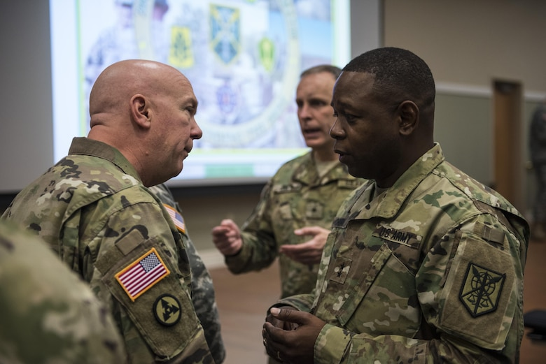 Maj. Gen. Phillip Churn (right), commanding general of the 200th Military Police Command, speaks with Brig. Gen. Peter Bosse, with the Army Reserve Engagement Cell (AREC), U.S. Army North, during a four-day workshop and Yearly Training Brief conference held by the 200th MP Cmd. in Columbus, Ohio, on April 2. During the event, the units' leaders worked to improve their readiness and briefed the commanding general and his command leadership on their units' status. AREC members from various Army Service Component Commands attended this YTB in order to grow partnerships between the 200th MP Cmd. and Army component commands across the globe. (U.S. Army photo by Master Sgt. Michel Sauret)