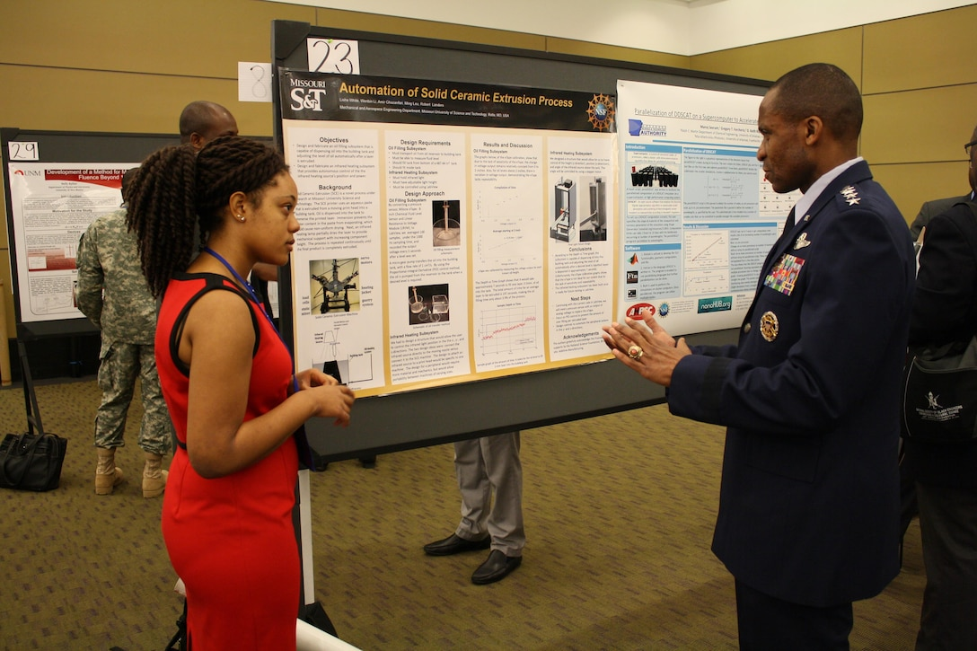 Gen. Darren McDew, the U.S. Transportation Command commander, speaks with a student about her engineering project at the 42nd annual convention of the National Society of Black Engineers on March 25, 2016, at the Boston Convention and Exhibition Center. The combatant command commander spoke with several groups while at the convention, as well as speaking with individual students about their efforts and ambitions. (Courtesy photo)