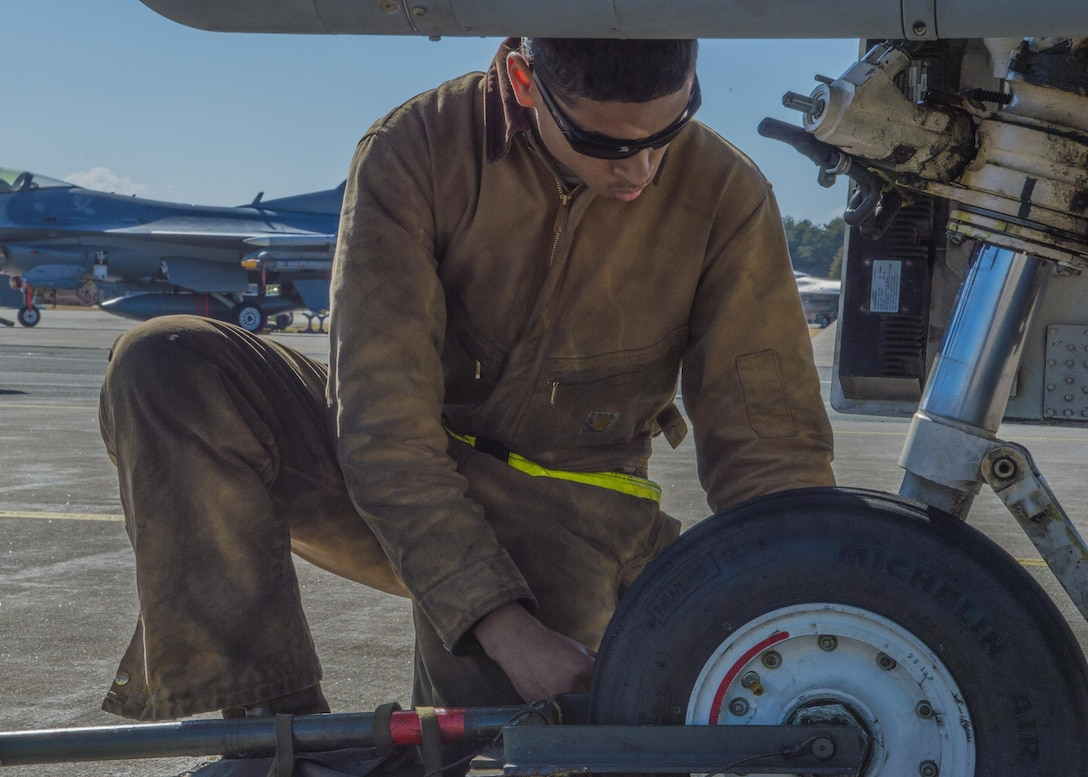 Senior Airman Kyle Lacy, a crew chief with the 35th Maintenance Squadron, performs a post-flight inspection on an F-16 Fighting Falcon during a surge exercise at Misawa Air Base, Japan, April 5, 2016. After aircraft land and return to their assigned crew chief, a post-flight inspection is conducted to ensure the aircraft didn't accrue damage. During the two-day operation, the amount of time allotted for these inspections is decreased which heightens the tempo and simulates a combat environment. (U.S. Air Force photo/Airman 1st Class Jordyn Fetter)