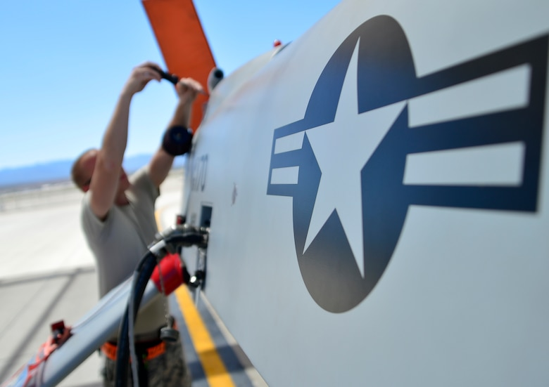 Senior Airman Jonathan, 432nd Aircraft Maintenance Squadron crew chief, take off an engine panel during a post-flight check April 5, 2015. Crew chiefs are responsible for supervising, monitoring, and directing aircraft maintenance. (U.S. Air Force photo by Senior Airman Christian Clausen/Released)