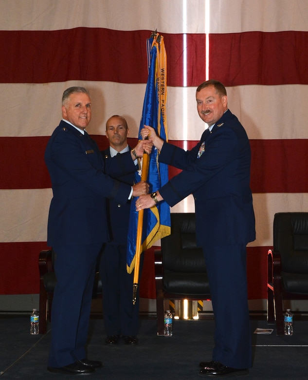 Maj. Gen. John C. Flournoy, Jr., Commander, Fourth Air Force, passes the guidon to the new 507th Air Refueling Wing commander, Col. Douglas E. Gullion, at the change of command ceremony April 2, 2016, at Tinker Air Force Base, Okla. Gullion is a command pilot who has served nearly 30 years and has flown more than 6,500 flight hours. (U.S. Air Force photo/Tech. Sgt. Lauren Gleason)