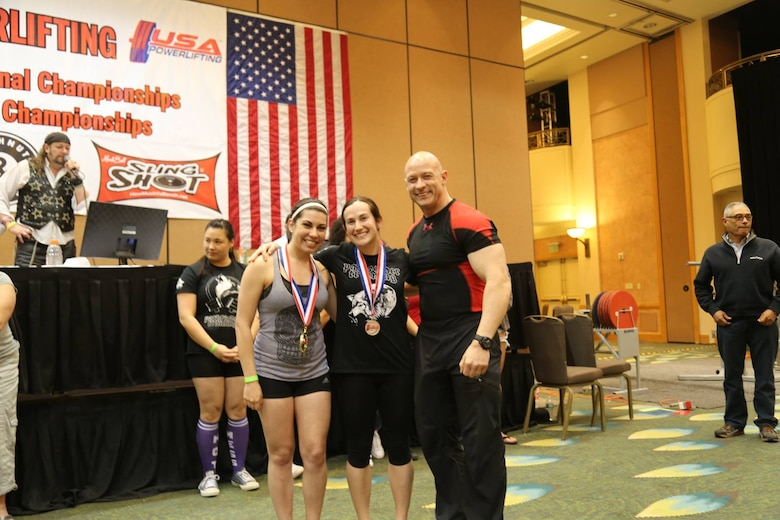 Alyssa, a senior airman from the 22nd Intelligence Squadron, and Ashlee, a staff sergeant from the 94th Intelligence Squadron, receive their Gold and Silver medals March 19, 2016 at the 24th USA Powerlifting Military National Championships in Orlando, Fla. Alyssa posted the following numbers 220 pounds for squat, 115 pounds for bench press, and 270 pounds for deadlift, giving her a total of 605 pounds total. Ashlee lifted 214 pounds for the squat event, 110 pounds for bench press, and 236 pounds for deadlift to total 560 pounds. (Courtesy photo)