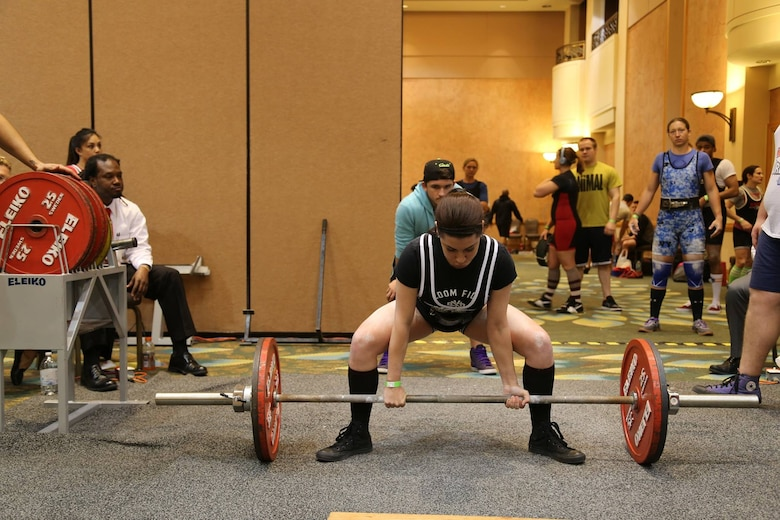 Alyssa, a senior airman from the 22nd Intelligence Squadron, prepares to perform a deadlift March 19, 2016 at the 24th USA Powerlifting Military National Championships in Orlando, Fla. Alyssa posted the following numbers 220 pounds for squat, 115 pounds for bench press, and 270 pounds for deadlift, giving her a total of 605 pounds total and took home a gold medal for her weight class. (Courtesy photo)