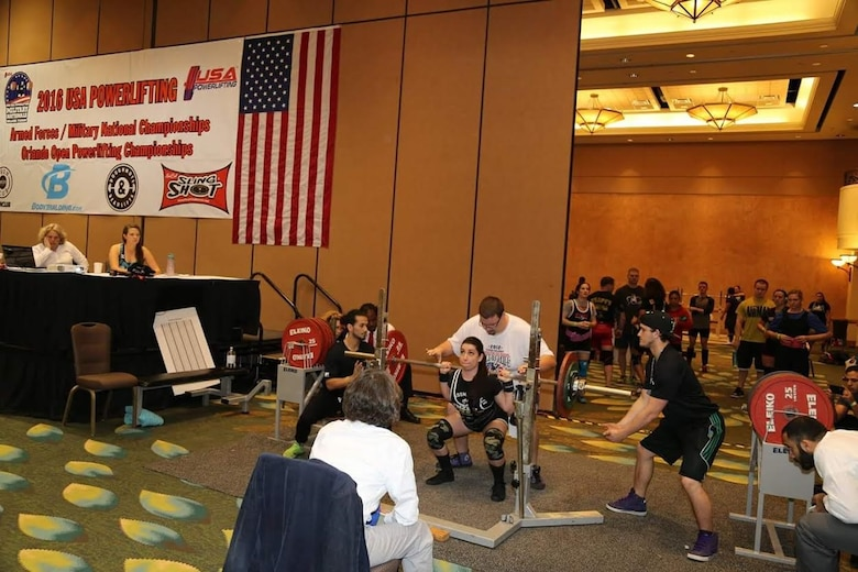 Alyssa, a senior airman from the 22nd Intelligence Squadron, performs a squat exercise March 19, 2016 at the 24th USA Powerlifting Military National Championships in Orlando, Fla. Alyssa posted the following numbers 220 pounds for squat, 115 pounds for bench press, and 270 pounds for deadlift, giving her a total of 605 pounds total and took home a gold medal for her weight class. (Courtesy photo)