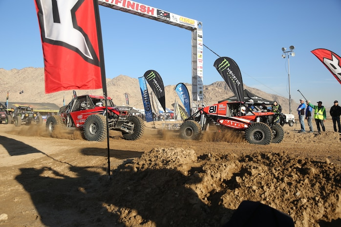 Two off-highway vehicles begin their respective vehicle class race during the 2015 King of the Hammers race in Johnson Valley Calif., Feb. 4, 2015.