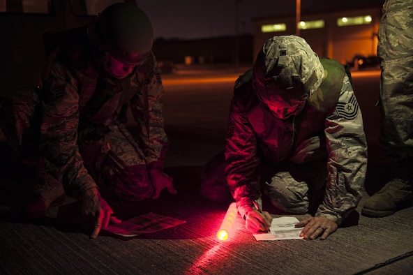 U.S. Air Force Airmen from the 18th Civil Engineer Squadron conduct nighttime airfield damage repair training at the Silver Flag training site April 5, 2016, on Kadena Air Base, Japan. The 18th CES plays an integral role as a fast response repair force by reestablishing damaged runways in order to maintain aircraft combat and logistical capabilities. (U.S. Air Force photo by Senior Airman Peter Reft/Released)