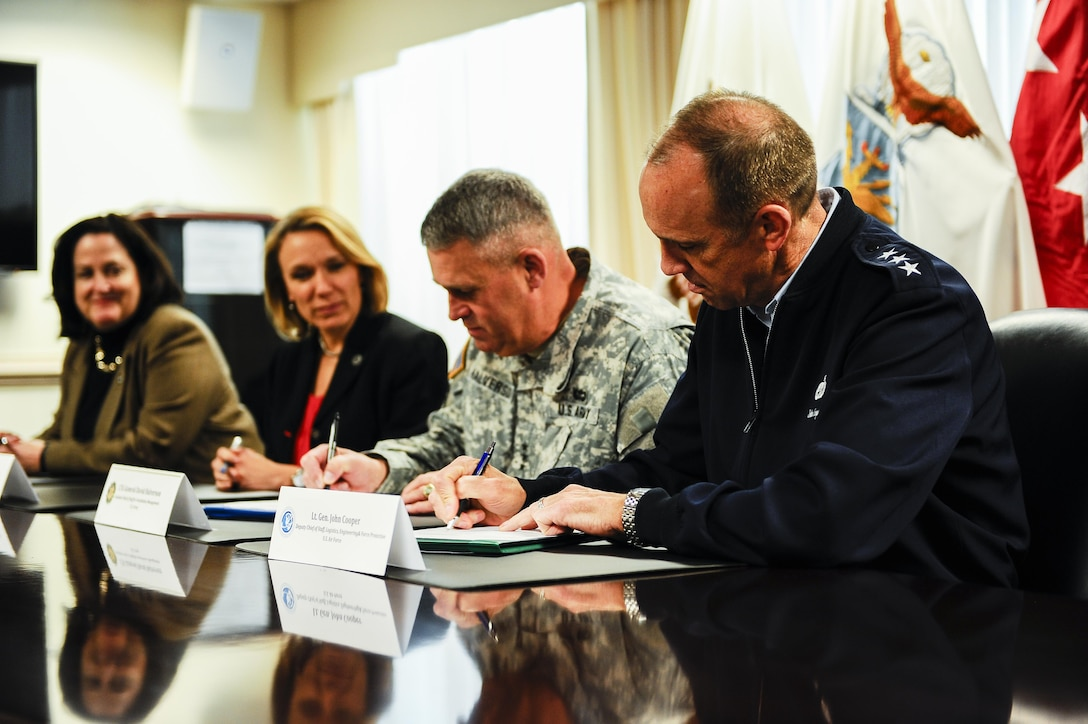 From front to back, Lt. Gen. John Cooper, the Air Force deputy chief of staff for logistics, engineering and force protection; Lt. Gen. David Halverson, the Army assistant chief of staff for installation management; Miranda Ballentine, the assistant secretary of the Air Force for installations, environment and energy; and Katherine Hammock, the assistant secretary of the Army for installations, energy and environment sign a memorandum of agreement that formalizes the partnership between the services' energy offices at the Pentagon, Washington, D.C., April 6, 2016. (U.S. Air Force photo/Tech. Sgt. Bryan Franks)