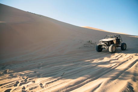 An off-highway vehicle zips through sand dunes in the Johnson Valley Shared Use Area.
