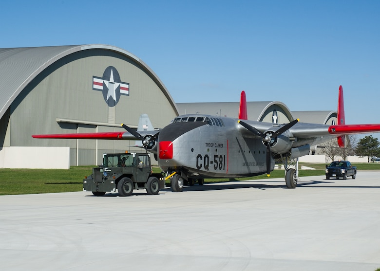 DAYTON, Ohio -- Fairchild C-82 Packet being moved into the fourth building at the National Museum of the United States Air Force on April 5, 2016. (U.S. Air Force photo by Ken LaRock)