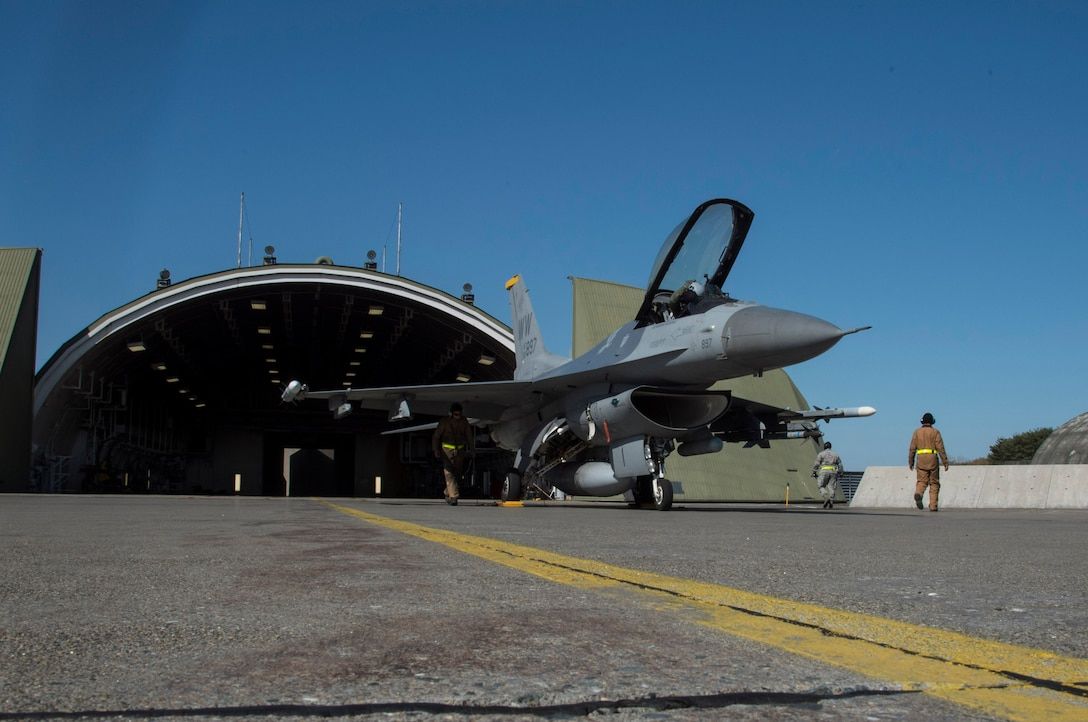 A U.S. Air Force F-16 Fighting Falcon sits on the flightline after a sortie during a two-day surge exercise at Misawa Air Base, Japan, April 5, 2016. During surge operations, the 35th Fighter Wing demonstrated their ability to generate aircraft in a combat-like scenario with an increase in sorties from between 10 to 20 each day, to approximately 70. (U.S. Air Force photo by Airman 1st Class Jordyn Fetter/Released)