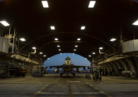 U.S. Air Force Airmen with the 35th Aircraft Maintenance Squadron arm an F-16 Fighting Falcon during a two-day surge exercise at Misawa Air Base, Japan, April 5, 2016. Along with standard maintenance to aircraft before and after flight, weapons load crew teams armed the aircraft to simulate a combat environment. During deployed operations, loading is essential for the F-16's air-to-air combat and air-to-surface attacks. (U.S. Air Force photo/Airman 1st Class Jordyn Fetter/Released)