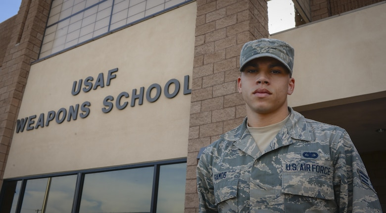Senior Airman Edward Ramos, United States Air Force Weapons School command section administrator, poses in front of the USAFWS at Nellis Air Force Base, Nev., April 4, 2016. Ramos assisted four passengers who were in a car wreck on March 25, 2016.
