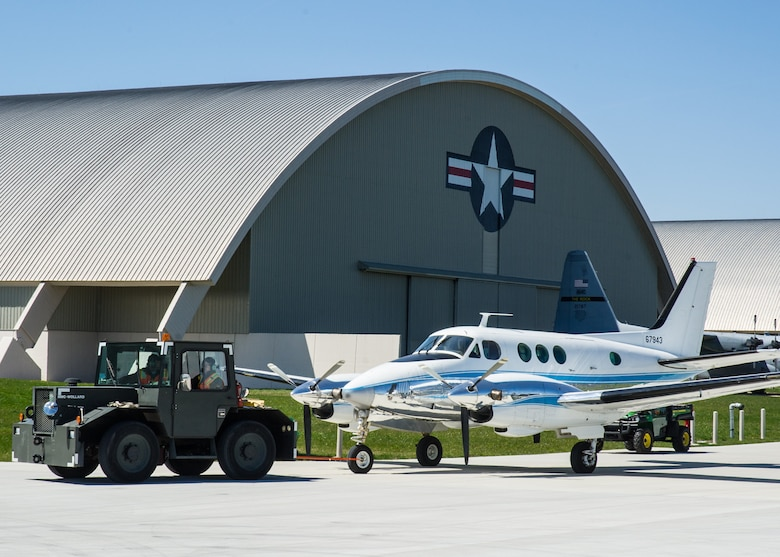 DAYTON, Ohio -- Beech VC-6A being moved into the fourth building at the National Museum of the United States Air Force on April 5, 2016. (U.S. Air Force photo by Ken LaRock)