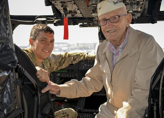 U.S. Air Force Maj. Clell Knight, a CV-22 Osprey pilot with the 8th Special Operations Squadron, smiles for a photo with retired Lt. Cmdr. Cass Phillips, a Pearl Harbor survivor, in the cockpit of a CV-22 at Hurlburt Field, Fla., April 5, 2016. Phillips was a U.S. Navy radioman based at Naval Air Station Kaneohe, Hi. during the Pearl Harbor Attacks and later served as a patrol bomber pilot. (U.S. Air Force photo by 2nd Lt. Jaclyn Pienkowski)
