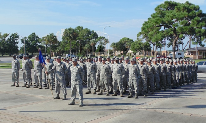 Members of the 325th Logistics Readiness Squadron participate in a retreat ceremony, Aug. 6, at Flag Park. The 325th Logistics Readiness Squadron won the Air Force's coveted 2015 Major General Warren R. Carter Daedalian Logistics Effectiveness Award. (U.S. Air Force courtesy photo)