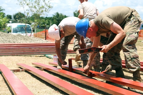 U.S. Soldiers paint support beams for Matangharon Elementary School, Barangay Matangharon, as part of the 32nd iteration of Exercise Balikatan, April 3, 2016. Matangharon Elementary School, damaged during last year's typhoon, is one of multiple humanitarian and civic assistance projects that demonstrate our commitment to training, cooperation and interoperability between the Philippines and the U.S. The annual bilateral exercise allows service members from both countries to train and enhance human assistance and disaster relief capabilities in the event of natural disasters or crisis endangerments.