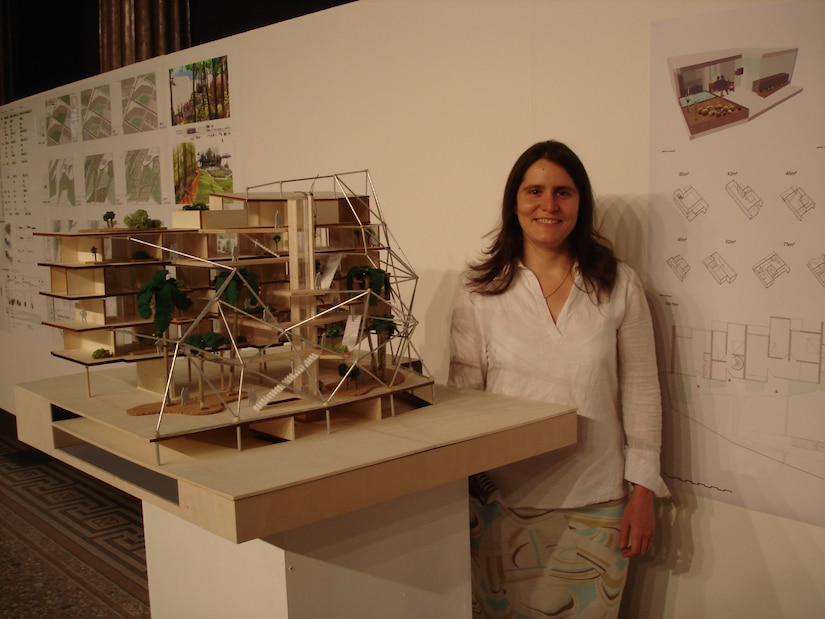 Army Sergeant Mariela Payan, 841st Transportation Battalion documentation non-commissioned officer, poses in front of her personal project; a scale model of a waterfront residential building design at the Academy of Fine Arts in Vienna, Austria, in June 2007. Before Payan joined the Army, she earned  a Bachelor's Degree in Architecture. Payan was recognized during Women's History Month for her overall professional skill and the importance of her job to the base and the rest of the East Coast. (U.S. Air Force photo/Airman 1st Class Thomas T. Charlton)