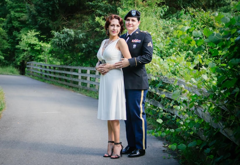 Army Sergeant Mariela Payan, 841st Transportation Battalion documentation non-commissioned officer, poses with her wife, Nelideisy Fernandez, at their wedding in South Carolina, in April 2015. Payan's family came from Cuba, Ireland, Indiana and North Carolina just to attendcome to their wedding. Payan was recognized during Women's History Month for her overall professional skills and the importance of her job to the base and the rest of the East Coast. (U.S. Air Force photo/Airman 1st Class Thomas T. Charlton)