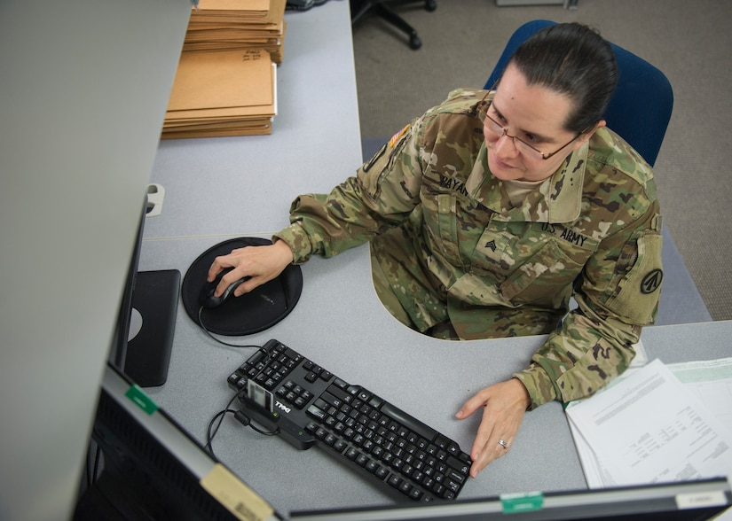 Army Sergeant Mariela Payan, 841st Transportation Battalion documentation non-commissioned officer, provides clearance for military cargo ships to dock at Joint Base Charleston – Naval Weapons Station, S.C., on March 14, 2016. Payan was recognized during Women's History Month for her overall professional skill and the importance of her job to the base and the rest of the East Coast. (U.S. Air Force photo/Airman 1st Class Thomas T. Charlton)