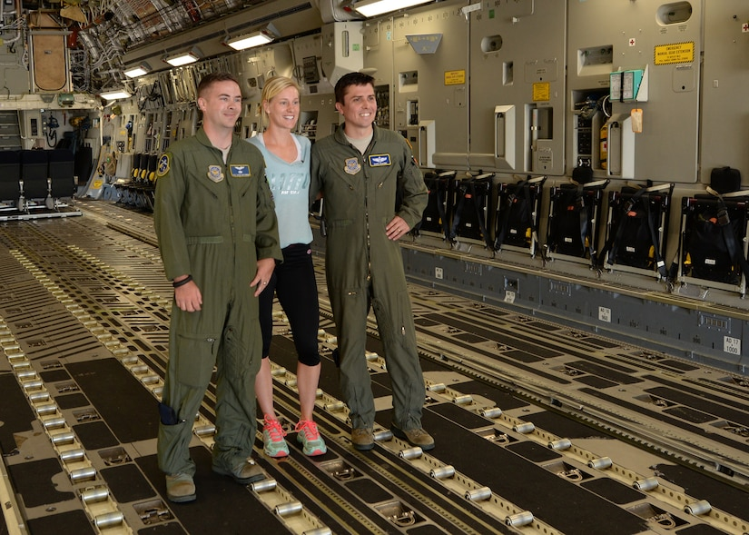 Staff Sgt. David McCubbin, 14th Airlift Squadron loadmaster, and Capt. David Schunk, 14th AS pilot, meet with Alison Riske, professional tennis player April 5, 2016, on a C-17 Globemaster III at JB Charleston – Air Base, S.C. Riske is in Charleston competing in the Family Circle Cup tennis tournament and visited the Air Base to sign autographs for Team Charleston members and tour a C-17 Globemaster III. (U.S. Navy photo/Mass Communications Specialist 1st Class Sean Stafford)