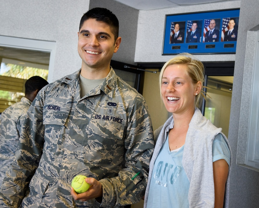 2nd Lt. Richard Scherl, 437th Aircraft Maintenance Squadron, receives an autographed tennis ball from Alison Riske, professional tennis player, April 5, 2016, at the fitness center on Joint Base Charleston – Air Base, S.C. Riske is in Charleston competing in the Family Circle Cup tennis tournament and visited the Air Base to sign autographs for Team Charleston members and tour a C-17 Globemaster III. (U.S. Air Force photo/Senior Airman Clayton Cupit)