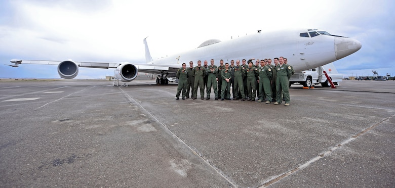 The joint Air Force and Navy crew of an E-6B Mercury Airborne Launch Control System aircraft, stationed with the 625th Strategic Operations Squadron based out of Offutt Air Force Base, Neb., pose for a picture on the tarmac of the Montana Air National Guard flight line in Great Falls, Mont., April 5, 2016. The Mercury crew serves as a last line of defense and redundancy program for the nation's nuclear command and control, and has the capability to launch an intercontinental ballistic missile from any launch facility in the nuclear triad. (U.S. Air Force photo/Airman Collin Schmidt)