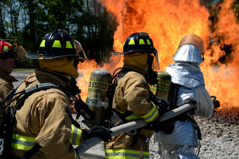 Airmen from Connecticut, Maine, New Jersey, Rhode Island and Vermont Air National Guard Fire Departments perform a live aircraft fire training exercise at 165th Airlift Wing's Regional Fire Training Facility in Savannah, Ga. on April 4th, 2016.  The airmen are conducting joint training exercises to maintain operational readiness. (U.S. Air National Guard photo by Tech. Sgt. Andrew J. Merlock/Released)