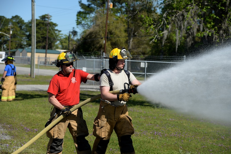 Airman 1st Class Joseph Frederickson (right) of the 143rd Airlift Wing, Rhode Island Air National Guard, and Staff Sgt. Paul Botting of the 158th Fighter Wing, Vermont Air National Guard conduct hose operation training at the 165th Airlift Wing's Regional Fire Training Facility, Savannah, Ga., on April 4th, 2016. (U.S. Air National Guard photo by Tech. Sgt. Andrew J. Merlock/Released)