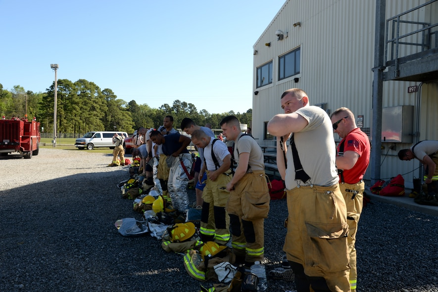 Airmen from Connecticut, Maine, New Jersey, Rhode Island and Vermont Air National Guard Fire Departments prepare to perform a live aircraft fire training exercise at 165th Airlift Wing's Regional Fire Training Facility in Savannah, Ga. on April 4th, 2016. (U.S. Air National Guard photo by Tech. Sgt. Andrew J. Merlock/Released)