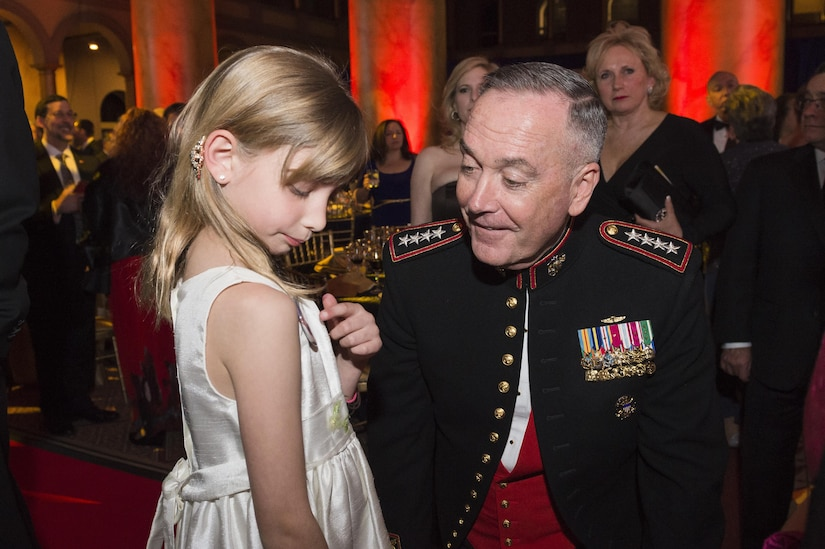 Marine Corps Gen. Joe Dunford, chairman of the Joint Chiefs of Staff, speaks to a military child during the Tragedy Assistance Program for Survivors 2016 Honor Guard Gala in Washington, D.C., April 6, 2016. During the event, Gen. Dunford was presented the TAPS Honor Guard Gala Military Award, accepting it on behalf of the men and women serving in our Armed Forces. DoD photo by Army Staff Sgt. Sean K. Harp