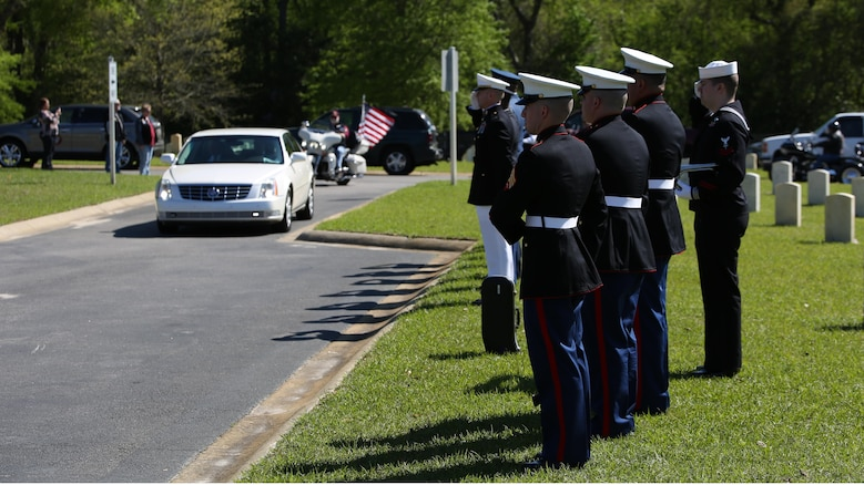 Service members salute the funeral cascade for Sgt. John Holladay, a World War II Marine Raider who was killed in action in 1943, as they drive into the National Cemetery in Florence, S.C., where Holladay was laid to rest April 4, 2016. During World War II, Holladay was assigned to Company B, 1st Marine Raider Battalion, 1st Marine Raider Regiment, who fought battles against Japanese positions along the Pacific front where he was killed.