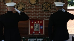 Marine Raiders currently assigned to Marine Special Operations Company B, 1st Marine Raider Battalion and U.S. Marine Corps Forces, Special Operations Command headquarters salute the remains of Sgt. John Holladay, a fallen World War II Marine Raider.  During World War II Holladay was assigned to Company B, 1st Marine Raider Battalion, 1st Marine Raider Regiment, who fought in U.S. Marine Corps battles against Japanese positions along the Pacific front, when he was killed in 1943.
