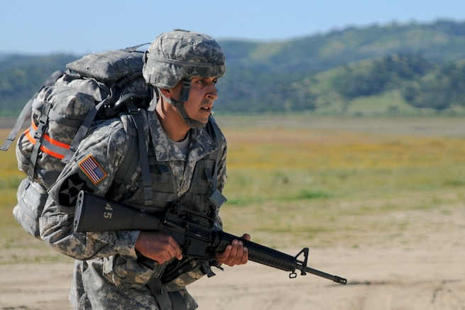 Staff Sgt. Antonio Palomera, from 152nd Theater Information Operations Group, competes in a ruck march at the U.S. Army Civil Affairs and Psychological Operations Command 2016 U.S. Army Best Warrior Competition at Fort Hunter Liggett, Calif., April 5, 2016. This year's Best Warrior competition will determine the top noncommissioned officer and junior enlisted Soldier who will represent USACAPOC in the Army Reserve Best Warrior competition later this year. (U.S. Army photo by Spc. Khadijah Lutz-Wilcox, USACAPOC)