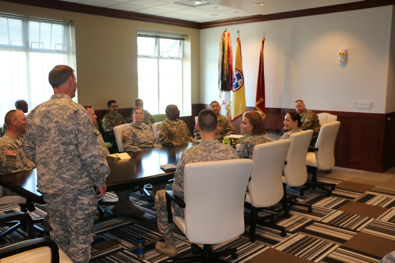 Army Reserve warrant officers from the 310th Sustainment Command (Expeditionary) meet with Brig. Gen. Vincent B. Barker for introductions and to brief him on warrant officer priorities and job specialties at the SPC Luke P. Frist Army Reserve Center, Ind., March 20, 2016.