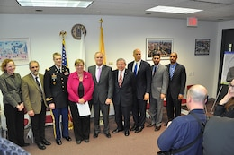 Col. David Caldwell, U.S. Army Corps of Engineers New York District (third person from the left), joins other elected, state, and federal officials for the Environmental Protection Agency announcement of the $1.4 billion Superfund Project for the Lower Passaic River in Newark, N.J., March 4, 2016. The Lower Passaic River Superfund project will remove 3.5 million cubic yards of toxic sediment, in an effort to revitalize the lower eight miles of the Passaic River. (Photo by Hector Mosley, public affairs specialist, New York District)