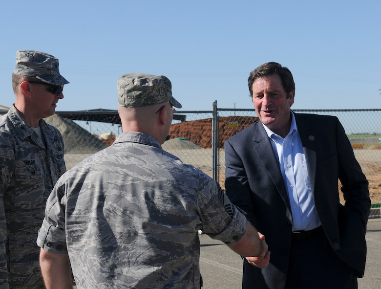 Chief Master Sgt. Edward R. Slacum, 548th Intelligence, Surveillance, and Reconnaissance Group superintendent (center), and Col. Drew Taylor, 548th ISRG deputy commander (left), welcome Congressman John Garamendi to Beale Air Force Base, California, Apr. 06, 2016. Garamendi met with 548th ISRG leadership to discuss the Distributed Ground Station-2 building construction progress. (U.S. Air Force photo by Senior Airman Michael J. Hunsaker)
