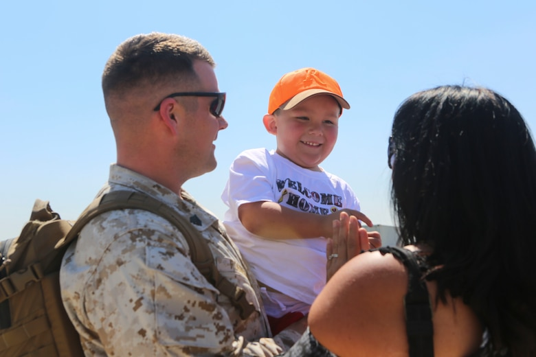A Marine returning from deployment reunites with his family aboard Marine Corps Air Station Miramar, Calif., April 4. Service members from Marine Wing Support Squadron (MWSS) 372, Marine Medium Tiltrotor Squadron (VMM) 363 and Marine Aviation Logistics Squadron (MALS) 16 returned from a six and a half month deployment with the Special Purpose Marine Air-Ground Task Force – Crisis Response – Central Command in support of Operation Inherent Resolve. (U.S. Marine Corps photo by Lance Cpl. Harley Robinson/Released)